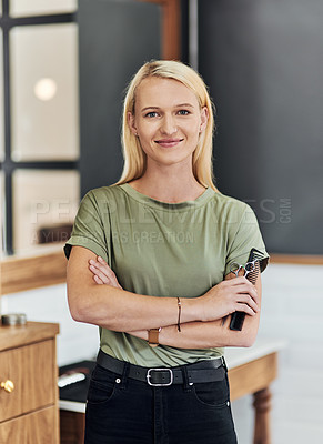 Buy stock photo Portrait of an attractive young hairdresser posing with her arms folded inside her salon