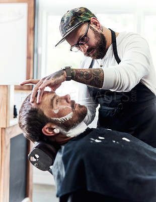 Buy stock photo Cropped shot of a handsome mature man getting his beard trimmed and lined up at a barbershop