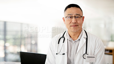 Buy stock photo Portrait of a handsome and mature doctor working inside of a hospital