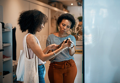 Buy stock photo Shot of two young women shopping in a waste free store