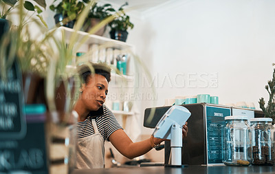 Buy stock photo Shot of a young woman using a smartphone while working in a waste free store