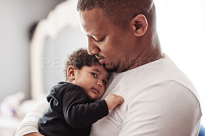 Buy stock photo Cropped shot of an affectionate young single father holding his adorable baby girl at home