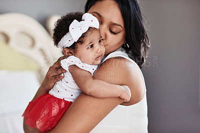 Buy stock photo Cropped shot of an affectionate young single mother holding her adorable baby girl on Christmas day
