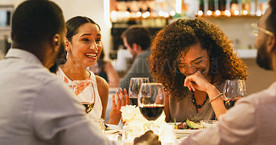 Buy stock photo Cropped shot of a group of cheerful young friends having a laugh together while dining in a restaurant