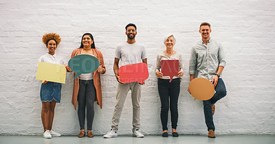 Buy stock photo Studio shot of a group of businesspeople holding colorful speech bubbles in a modern office