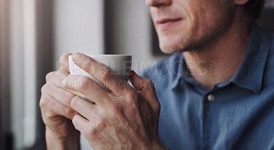 Buy stock photo Cropped shot of an unrecognizable man having coffee in a coffee shop
