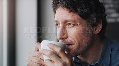Buy stock photo Cropped shot of a customer looking thoughtful while sitting in a coffee shop