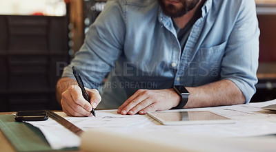 Buy stock photo Cropped shot of a businessman using a digital tablet while designing a blueprint in a creative office