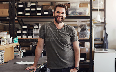 Buy stock photo Portrait of a confident businessman working in a creative office