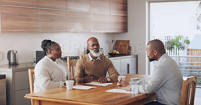 Buy stock photo Cropped shot of a senior couple sitting with their financial advisor in their home during the day