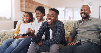 Buy stock photo Cropped shot of a happy young family sitting together and bonding while watching a movie in their home