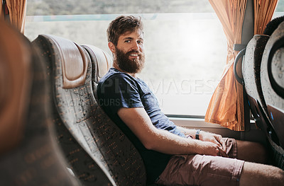 Buy stock photo Cropped shot of a handsome young man taking the bus