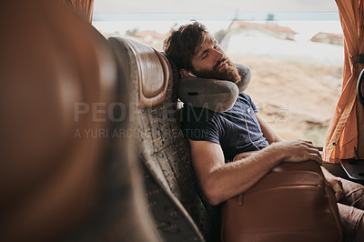Buy stock photo Shot of a passenger sleeping on the bus
