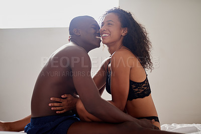 Buy stock photo Cropped shot of an affectionate young couple being intimate in their bedroom at home