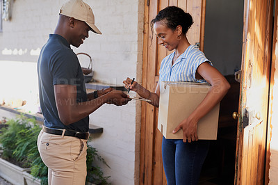 Buy stock photo Cropped shot of an unrecognizable woman signing for a parcel from a delivery man during a day off at home