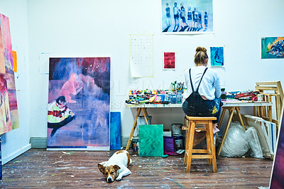 Buy stock photo Rearview shot of an unrecognizable woman painting in an art studio