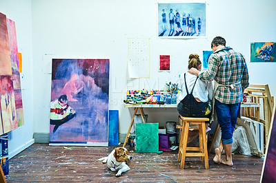 Buy stock photo Rearview shot of an unrecognizable couple painting together in an art studio