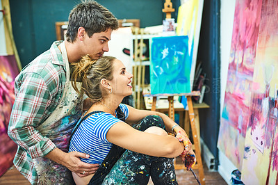 Buy stock photo Cropped shot of an artistic young couple looking at their canvas painting in an art studio