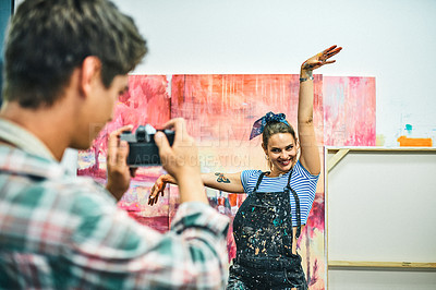 Buy stock photo Cropped shot of an unrecognizable man using a camera and taking pictures of his attractive girlfriend in her art studio