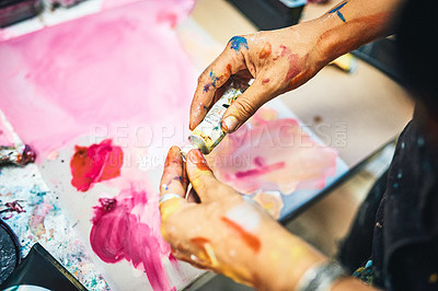 Buy stock photo Cropped shot of an unrecognizable woman preparing her paints for an art session in her studio