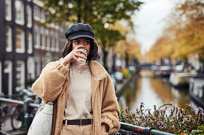 Buy stock photo Shot of a beautiful young woman having coffee in the city