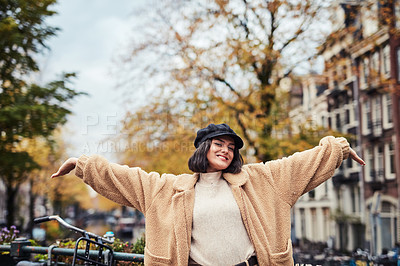 Buy stock photo Shot of a beautiful young woman celebrating while out and about in the city