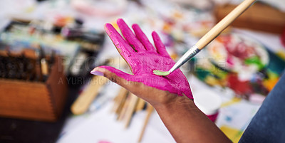 Buy stock photo Cropped shot of an unrecognizable woman painting her hand pink