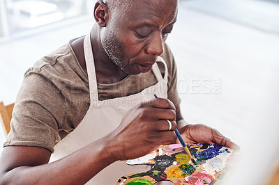Buy stock photo Cropped shot of a middle aged man painting in a art studio