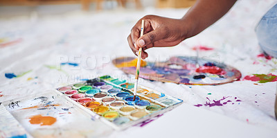 Buy stock photo Cropped shot of an unrecognizable woman using a paintbrush and paint palette