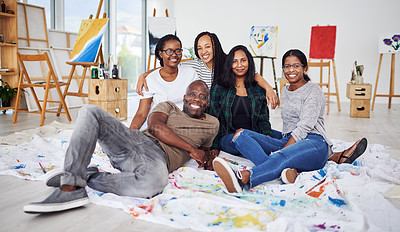 Buy stock photo Shot of a group of artists sitting together in a art studio