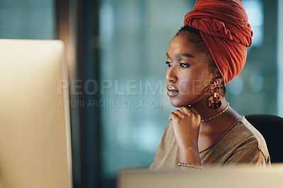 Buy stock photo Cropped shot of an attractive young businesswoman working on her computer in the office