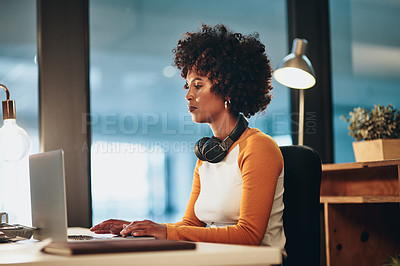 Buy stock photo Cropped shot of an attractive young businesswoman working on her laptop in the office