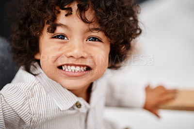 Buy stock photo Portrait of an adorable little boy relaxing and enjoying himself at home