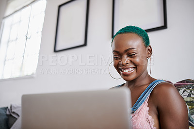 Buy stock photo Shot of a young woman using a laptop at home