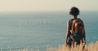 Buy stock photo Rearview shot of a young woman looking at the view while out on a hike