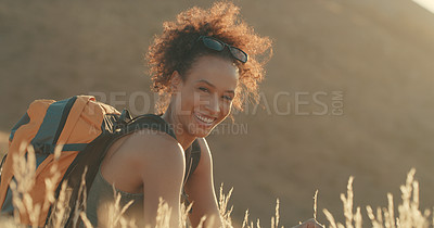 Buy stock photo Portrait of a young woman taking a break while out on a hike