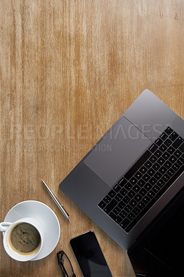Buy stock photo High angle shot of a productive workspace over a wooden surface