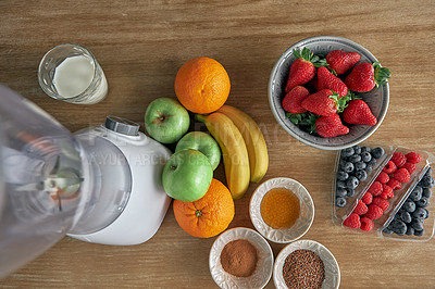 Buy stock photo High angle shot of a variety of ingredients laid out on a kitchen counter top before preparing a meal