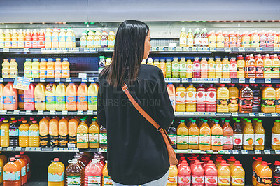 Buy stock photo Rearview shot of a young woman shopping in a grocery store