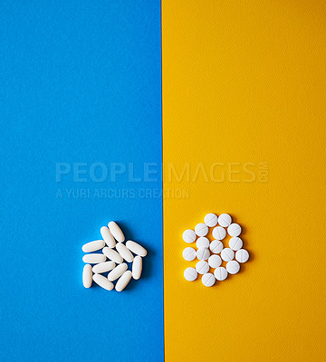 Buy stock photo Studio shot of two types of tablets placed adjacent to each other against a mixed background