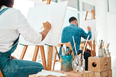 Buy stock photo Cropped shot of two unrecognizable artists sitting and sketching on a canvas during a painting session in an art studio