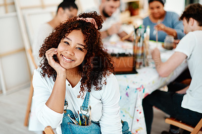 Buy stock photo Cropped portrait of an attractive young woman sitting with her friends during an art class in the studio