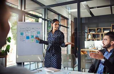 Buy stock photo Cropped shot of a young businesswoman leading a meeting in the boardroom