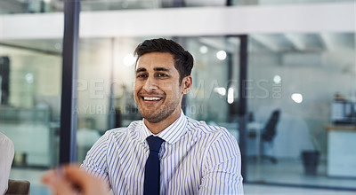 Buy stock photo Cropped shot of a handsome young man working in an office