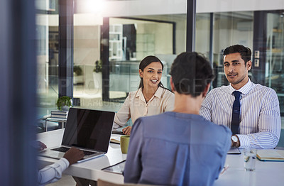 Buy stock photo Cropped shot of a group of people having a meeting in the boardroom