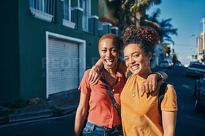 Buy stock photo Cropped portrait of an attractive young woman standing with her friend during an enjoyable day out in the city