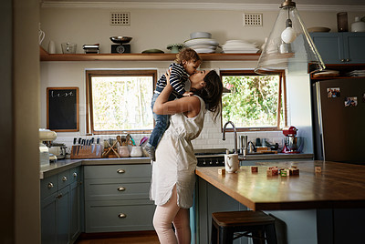 Buy stock photo Shot of a young woman spending quality time with her adorable child at home