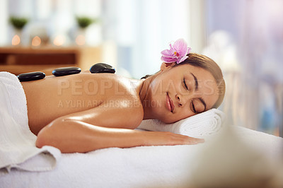 Buy stock photo Cropped shot of an attractive young woman lying on a massage table in a beauty spa