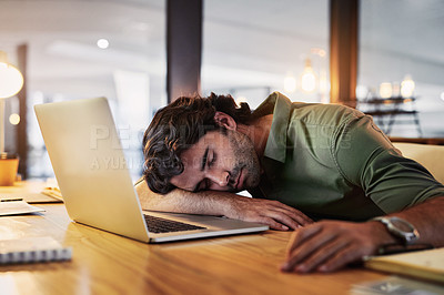 Buy stock photo Shot of a young businesswoman sleeping at her desk during a late night in a modern office
