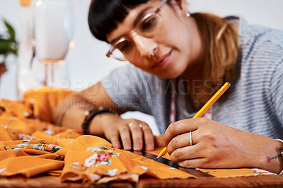 Buy stock photo Cropped shot of an unrecognizable woman making a garment at home